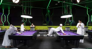 Dubai, United Arab Emirates, January 5, 2017 Hub Zero, an immersive entertainment hub, is a fully interactive gaming experience located in City Walk shopping mall. On this picture: Emirati boys are playing pool. From the series 'Bread and Circuses'