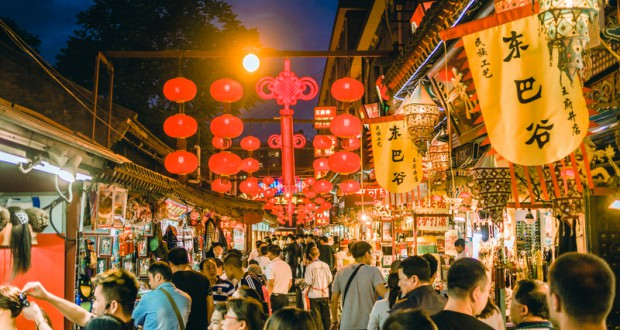 Beijing, China - May 5, 2015: Street market in Beijing, China filled with stores and people looking around